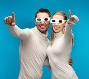 Man and woman with 3d glasses Stock Image