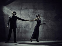 Man and woman dancers, concrete building surroundings Royalty Free Stock Photo