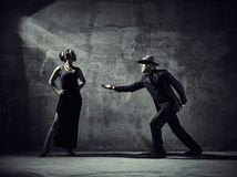 Man and woman dancers, concrete building surroundings Stock Image
