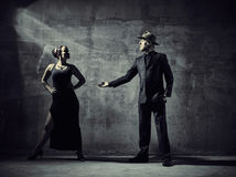 Man and woman dancers, concrete building surroundings Royalty Free Stock Image