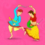 Man and woman dancing on Dandiya night Royalty Free Stock Photography