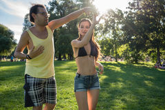 Man and woman dancing Latin American in park Stock Photography