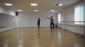Man and a woman are dancing in the studio stock video