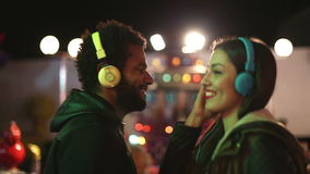 Man and woman dancing to the rhythm of music with headphones stock video footage