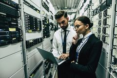 Man and woman in data centre royalty free stock photos