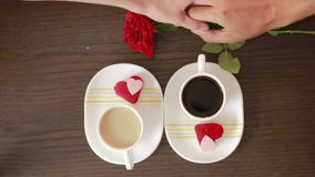 Man and woman on a date at a cafe. drink coffee and cake. gives flowers. Man and woman on a date at a cafe. drink coffee and cake stock footage