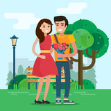 Man and woman on a date with flowers. Stock Photo