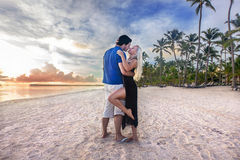 Man and woman - dawn at the beach. Couple men and women - romantic dawn at the beach stock photography