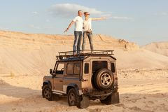 Man and a woman in the desert on a car. Royalty Free Stock Photos