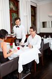 Man and woman for dinner in restaurant Stock Photos