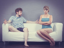 Man and woman in disagreement sitting on sofa Royalty Free Stock Photo