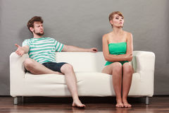 Man and woman in disagreement sitting on sofa Stock Photo