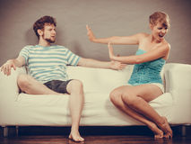 Man and woman in disagreement sitting on sofa Stock Image