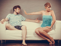 Man and woman in disagreement sitting on sofa Royalty Free Stock Images