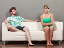 Man and woman in disagreement sitting on sofa Stock Photography