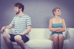 Man and woman in disagreement sitting on sofa Royalty Free Stock Photos