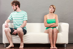 Man and woman in disagreement sitting on sofa Stock Photos
