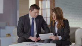 Man and woman discussing business matters in office, slow motion. Stock footage stock footage