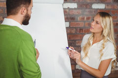Man and woman discussing during presentation Royalty Free Stock Image