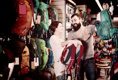 Man and woman discussing the purchase of rucksacks stock image