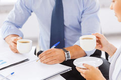 Man and woman discussing something in office Stock Images