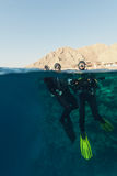 Man and woman divers Stock Photos
