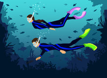 Man and Woman in diving wetsuits snorkeling. Exploring underwater world with fishes, corals, reefs Stock Photo