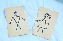 Man and woman divorce drawing torn apart. On blue background. Divorce couple, divorced Stock Image
