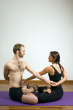 Man and Woman do Yoga - Vertical Royalty Free Stock Image