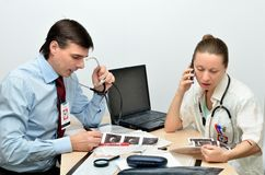 Man and woman doctors at work Stock Photo