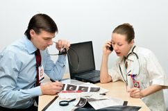 Man and woman doctors at work Royalty Free Stock Photo
