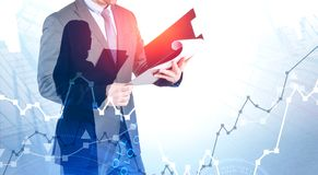 Man and woman with documents, stock market royalty free stock photo