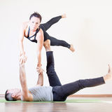 Man and woman doing acro yoga or pair yoga indoor Stock Photography