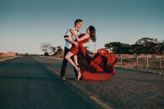 Man and Woman Doing Dance Post in Concrete Road at Daytime Royalty Free Stock Images
