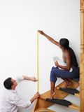 Man and woman doing diy work at home Stock Images