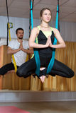 Man and woman doing exercises fly-yoga stock photo