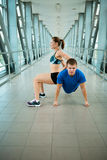 Man and woman doing exercises in the modern bridge construction Royalty Free Stock Images