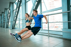 Man and woman doing exercises in the modern bridge construction Stock Image