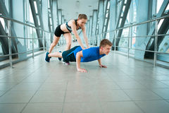Man and woman doing exercises in the modern bridge construction Stock Photos