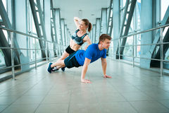 Man and woman doing exercises in the modern bridge construction Stock Photography