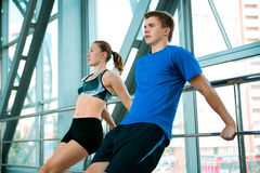 Man and woman doing exercises in the modern bridge construction Royalty Free Stock Photos
