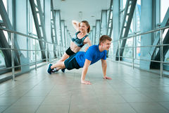 Man and woman doing exercises in the modern bridge construction Stock Images