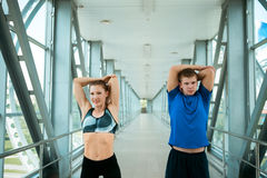 Man and woman doing exercises in the modern bridge construction Stock Photo