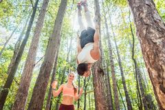 Man and woman doing functional fitness in outdoor gym royalty free stock image