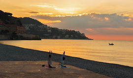 Man and woman doing gymnastics on the beach Royalty Free Stock Photography