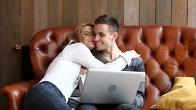 Man and woman doing online shopping stock video footage