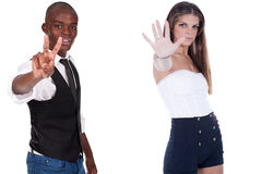 Man and woman doing signs Royalty Free Stock Image