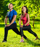 Man and woman doing stretching exercises Stock Photography