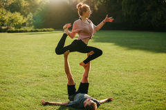 Man and woman doing various yoga poses in pair Royalty Free Stock Image