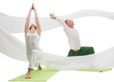 Man and woman doing yoga exercises in studio Royalty Free Stock Photos